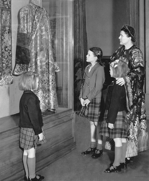 Miriam and daughters looking at Chinese robes at the Minneapolis Institute of Art, 1942